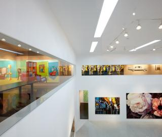 view from the upper galleries across the white cube space